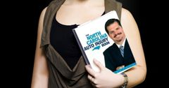 Stock photo of a woman holding a copy of the North Carolina Auto Injury Book written by attorney R. Clarke Speaks