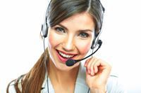 Stock photo of a female call center employee wearing a headset